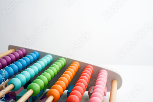 Photo Chinese calculator Abacus with colorful beads - Close-up