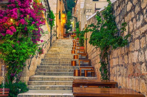narrow-street-and-street-cafe-decorated-with-flowers-hvar-croatia