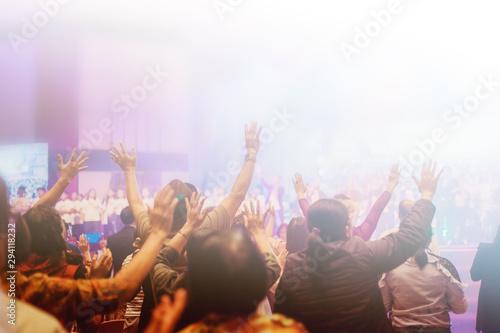 Carta da parati Soft focus of Christian worship with raised hand,m