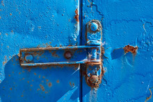 Rusty Hinge On Old Blue Rusty Metal Door, Closeup