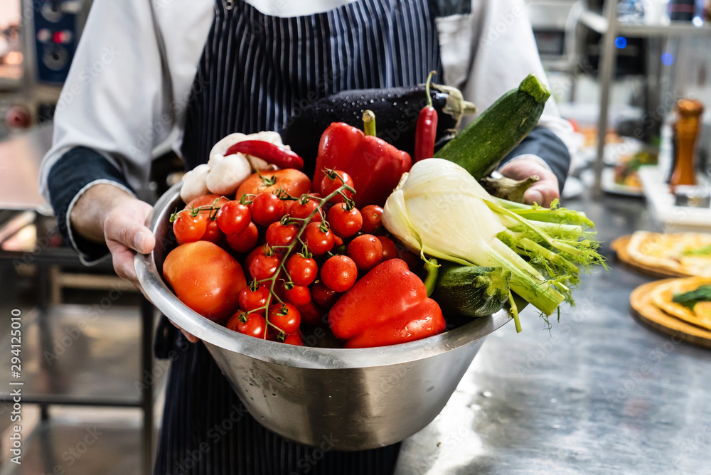 Fototapeta chef with fresh organic vegetables