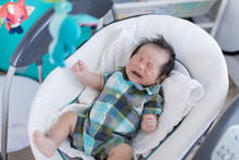 Cute Baby Laying In Bouncer Ch...