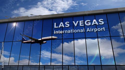 Airplane landing at Las Vegas Nevada mirrored in terminal Canvas Print