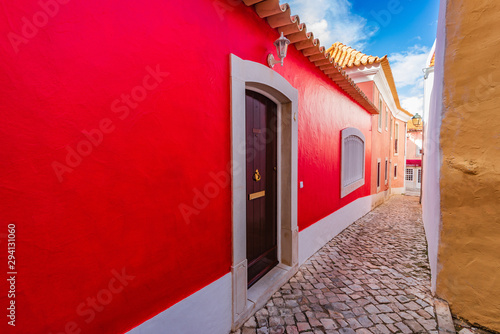 old-narrow-street-with-red-house-in-cascais-portugal
