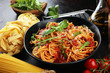 canvas print picture - Plate of delicious spaghetti Bolognaise or Bolognese with savory minced beef and tomato sauce garnished with parmesan