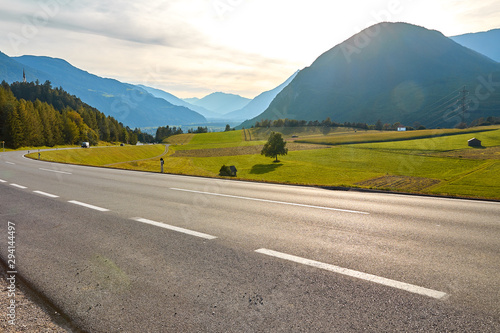 Montage in der Fensternische Grau Mountain road in Germany, between green fields and mountain landscapes