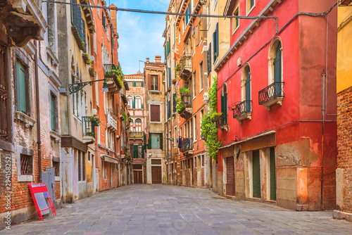 Fototapeta Colorful houses in the old medieval street in Venice, Italy obraz