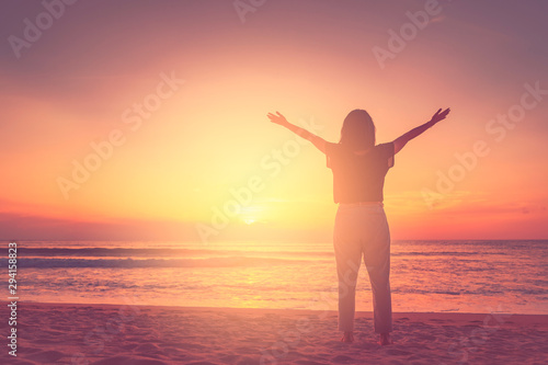 Montage in der Fensternische Hochrote Copy space of woman rise hand up on sunset sky at beach and island background.