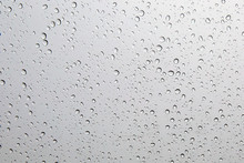 Water Droplets On The Glass When It Rains For Background And Textured.