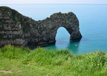 Kayaking At Durdle Door On The Jurasic Coast In Dorset