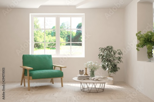 Mock up of stylish room in white color with armchair and green landscape in window Canvas Print