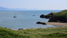 2 Yachts Moored Off The Llanddwyn Peninsular In Anglesey, North Wales