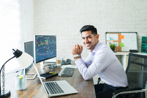 Happy Attractive Young Stock Broker Working At Home Canvas Print