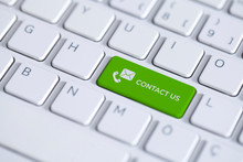 Green Key With Contact Us Icon.