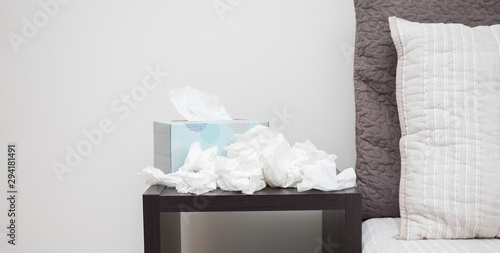 A pile of dirty kleenex on nightstand Wallpaper Mural