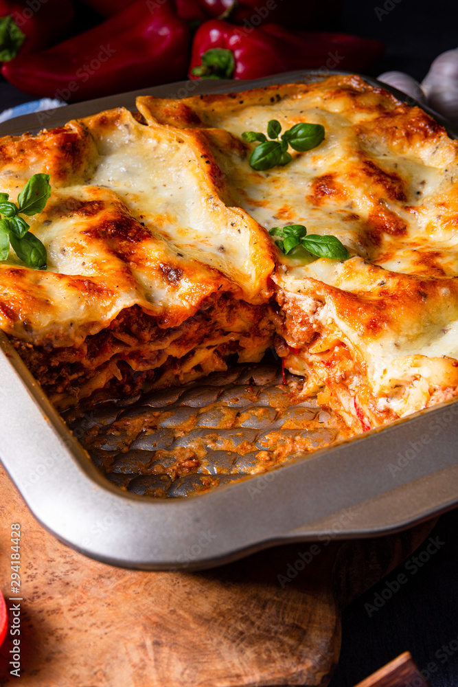 Fototapety, obrazy: rustic spicy lasagne with basil on the tin.
