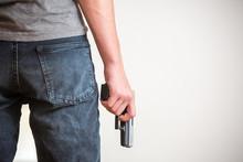Man Holding A Gun In His Hand ...