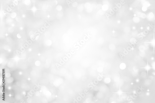 Fototapeta abstract blur white  and silver color background with star glittering light for show,promote and advertisee product and content in merry christmas and happy new year season collection concept	 obraz