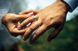 canvas print picture - Young bride put a gold wedding ring on the groom's finger, close-up. Wedding ceremony, exchange of rings. On the hand of man wearing a wedding ring.