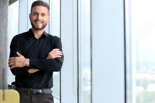 Fototapeta Modern business man is standing near window in the office obraz