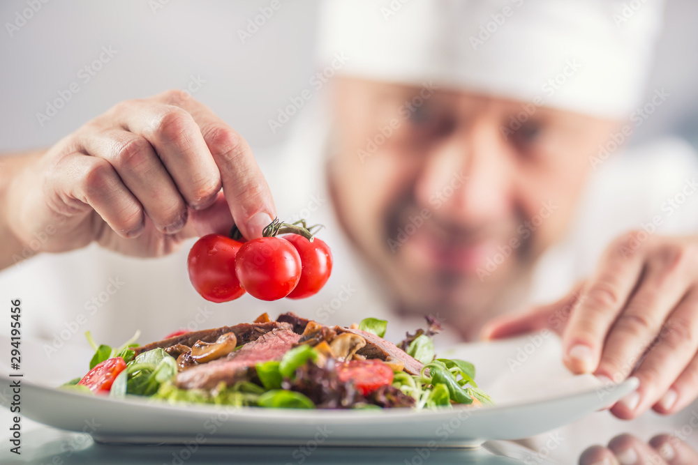 Fototapety, obrazy: Chef in the kitchen of the hotel or restaurant decorates the food just before serving