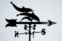 The Silhouette Of A Vane With ...