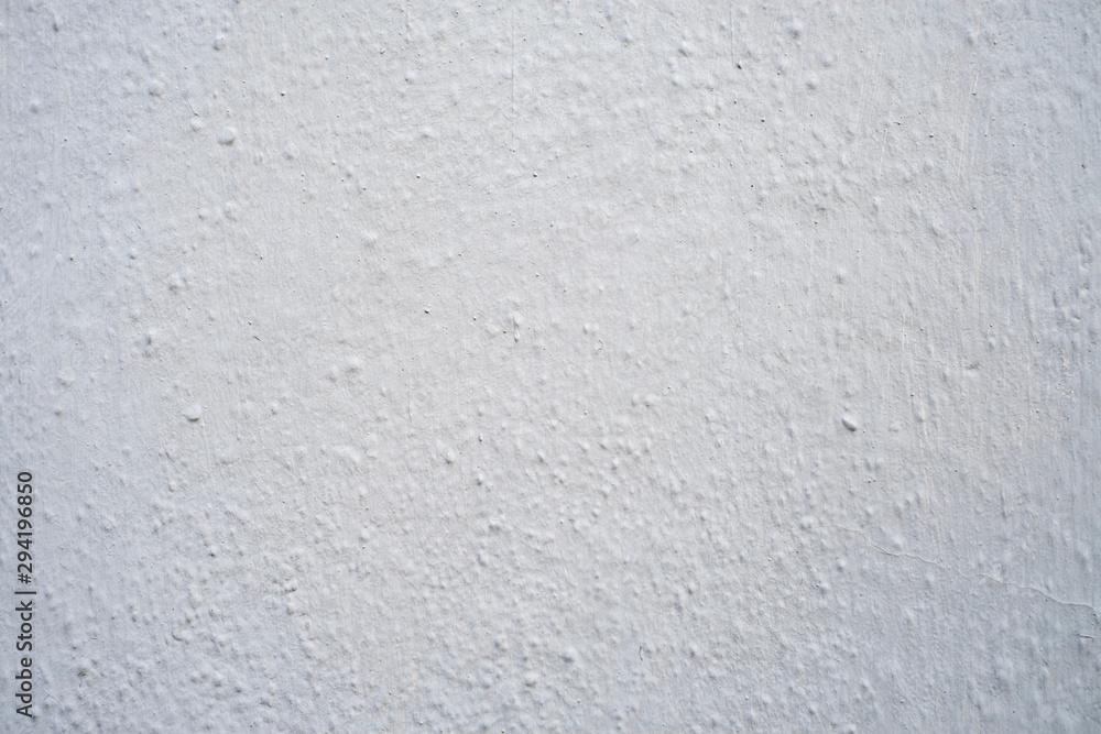 Fototapeta Rough bumpy white or gray stucco or concrete - background or texture