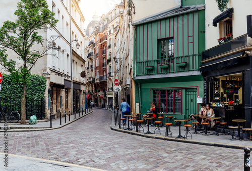 Cozy street with tables of cafe in Paris, France