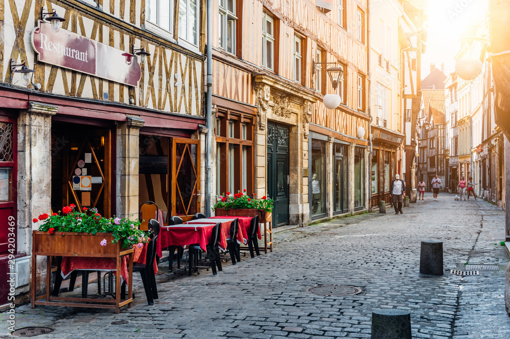 Fototapeta Cozy street with timber framing houses and tables of restaurant in Rouen, Normandy, France