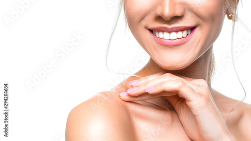 Fotomural  Dental health concept: woman smiling close up. Isolated on white.
