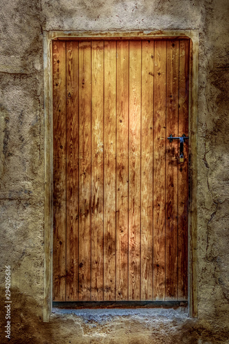 Close up view of a traditional wooden door with ornaments. Marrakech, Morocco.