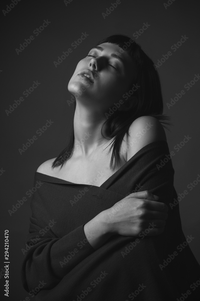 Fototapeta Passionate young woman in studio. Black and white.