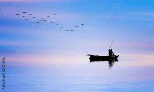 Garden Poster Sunset pescador en su barco de madera por el mar en calma al amanecer