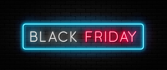 Black Friday sale. Black Friday neon sign on brick wall background. Glowing white and red neon text in blue frame for advertising and promotion. Banner and background, brochure and flyer design