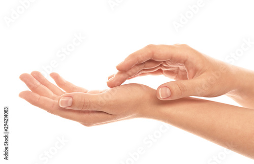 Obraz na plátne Young woman showing hands on white background, closeup