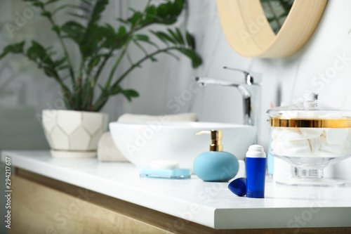 Stick deodorant and different toiletry on countertop in bathroom, space for text Wallpaper Mural