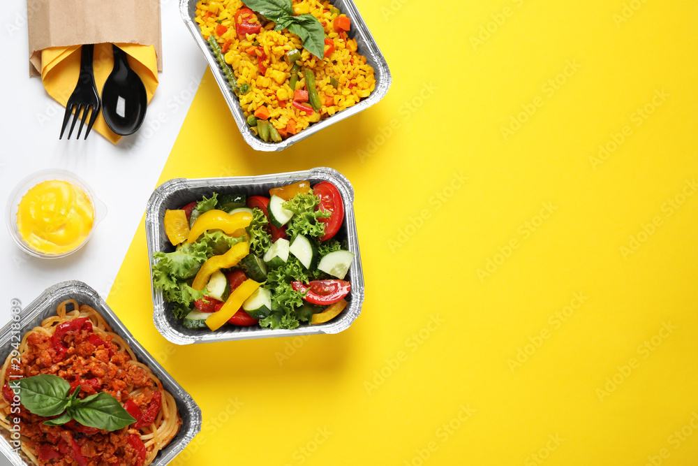 Obraz Lunchboxes on color table, flat lay. Healthy food delivery fototapeta, plakat