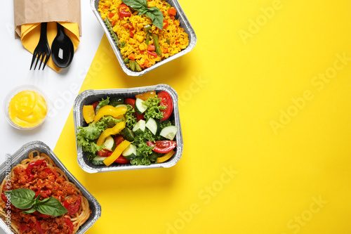 Fototapeta Lunchboxes on color table, flat lay. Healthy food delivery obraz