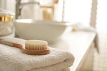 Hairbrush On Towel On Countert...