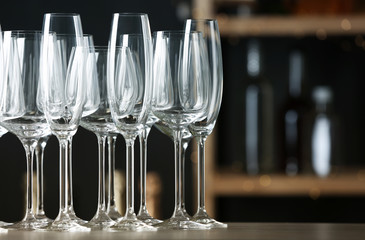 Empty clean glasses on counter in bar, space for text