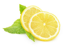 Isolated Lemon And Mint. Two Pieces Of Lemon Fruit And Fresh Mint Leaves Isolated On White Background With Clipping Path