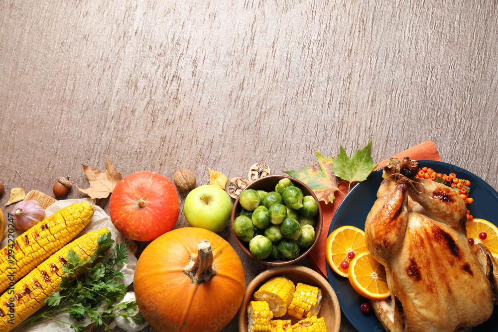 Fototapety, obrazy: Flat lay composition with delicious turkey on wooden background, space for text. Happy Thanksgiving day