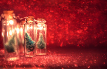 Close-up, Elegant Christmas Tree In Glass Jar With Glitter Background. Copy Space.