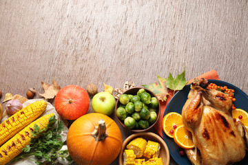 Flat lay composition with delicious turkey on wooden background, space for text. Happy Thanksgiving day