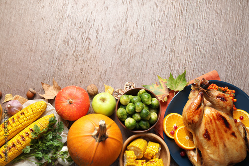 Photo Stands India Flat lay composition with delicious turkey on wooden background, space for text. Happy Thanksgiving day