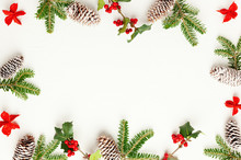 Christmas Background With Pine Cones, Branches Of Holly With Red Berries And Fir Tree On White. Winter Festive Nature Concept. Flat Lay, Copy Space.