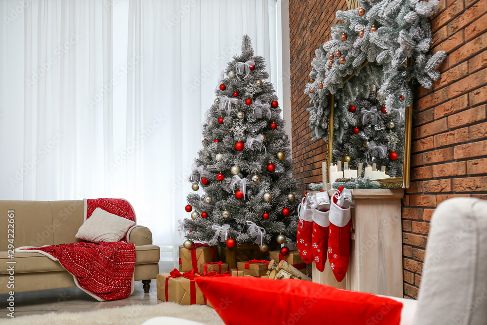 Fototapeta Stylish interior with beautiful Christmas tree and decorative fireplace