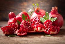 Fresh Ripe Pomegranates With Leaves