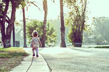 Little Girl Walking On The Roa...