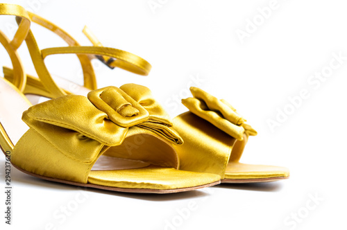 Yellow female sandals on white